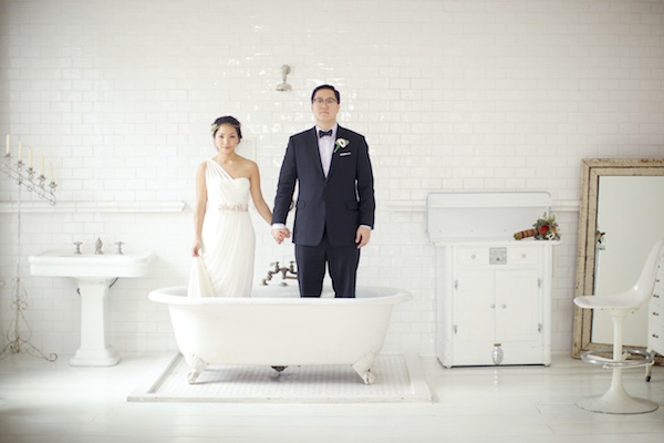 bride and groom in tub