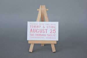 CUTE-SAVE-THE-DATE-CANVAS-ON-EASEL 1