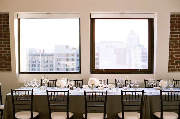 grey tablecloth with white centerpiece