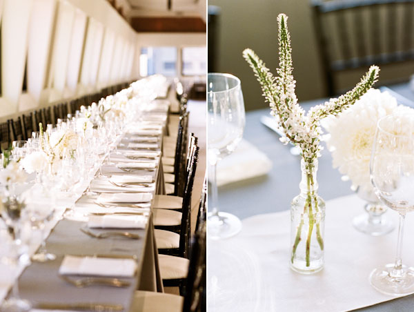 white centerpieces on grey linens