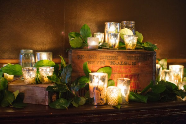 candle and ivy wedding arrangement