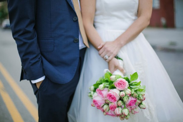 wedding couple with pink bouquet
