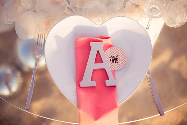 initial placesetting with pink napkin