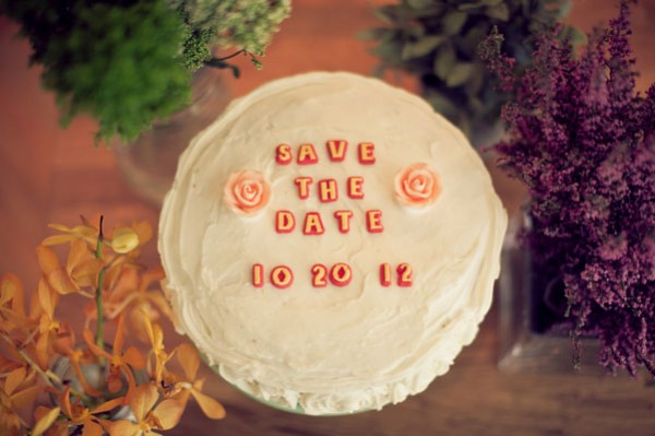 red and white save the date cake