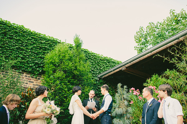 ceremony at jungle design in front of green wall