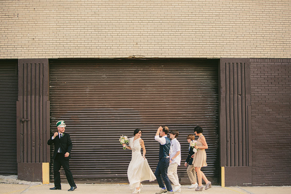 wedding party marching to the reception in brooklyn
