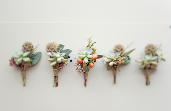 boutonnieres in green and orange