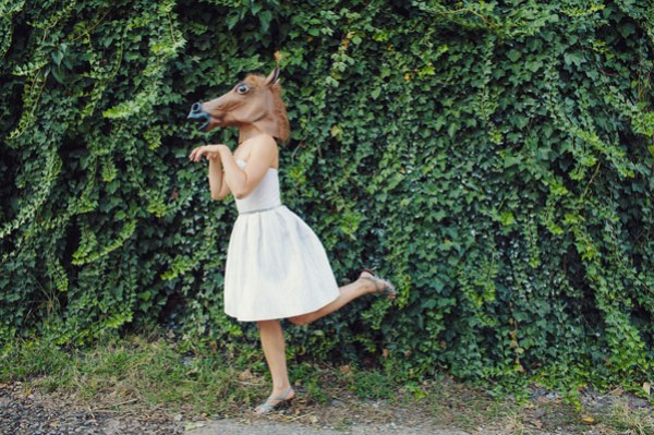 bride wearing horse mask