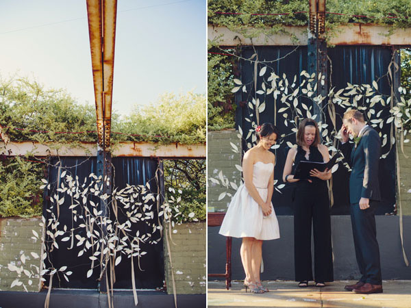 outdoor ceremony in front of white garland