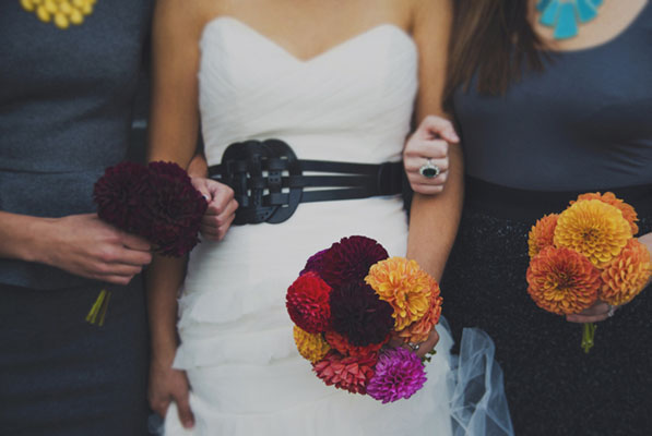wedding dress with black sash and ombre bouquet