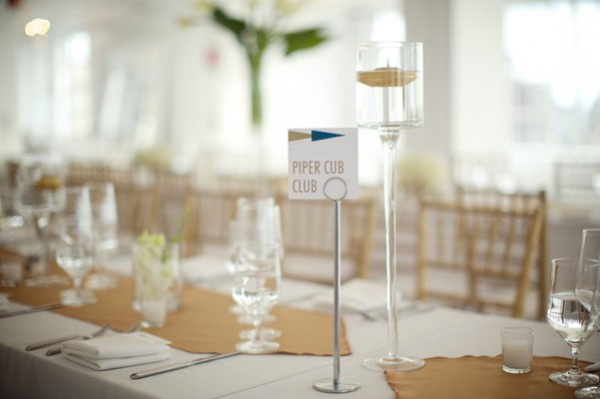 modern white and gold reception table