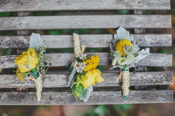 yellow and grey boutonnieres