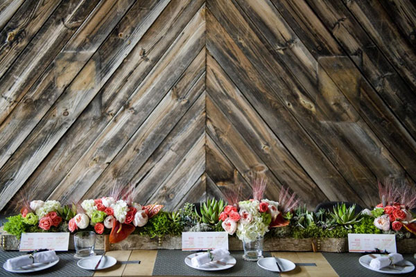 rustic wood backdrop with modern centerpieces