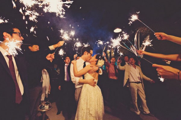 green building wedding reception with sparklers