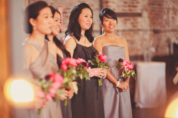 bridesmaids in grey with pink bouquets