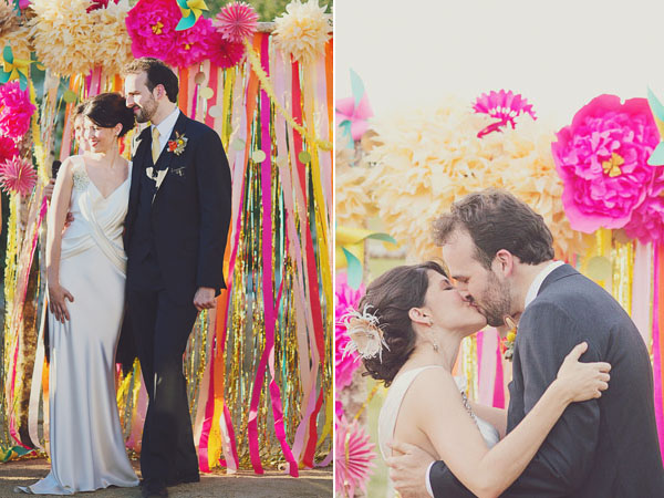 colorful pompom and streamer ceremony backdrop