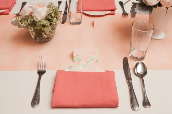peach table decor with menu