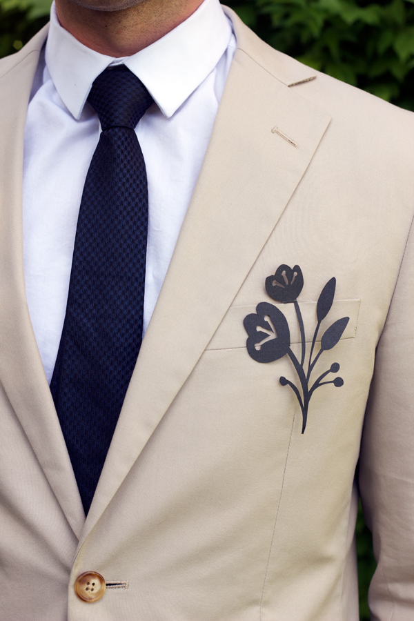 paper boutonniere Leave the tough stuff to your professional florist, but if you want to add a handcrafted touch, try making the groom's boutonniere.