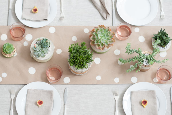 succulent centerpieces on kraft runner