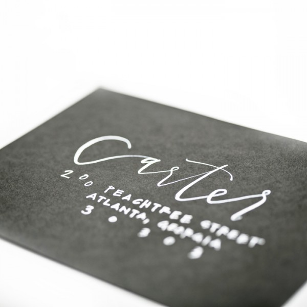 white calligraphy on black envelope