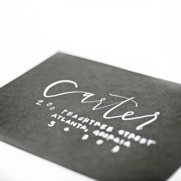 white calligraphy on black envelope