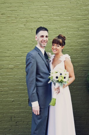 green building bride and groom