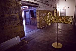 gold fringe arrow signage