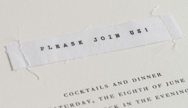 stitched invitation detail