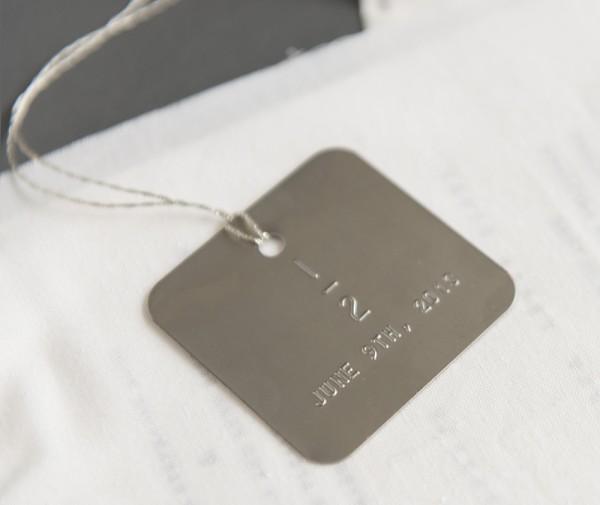 metal date tag
