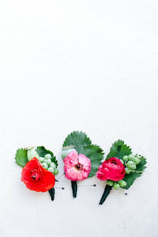 bright red boutonnieres