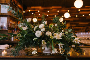 White Centerpiece with Greenery
