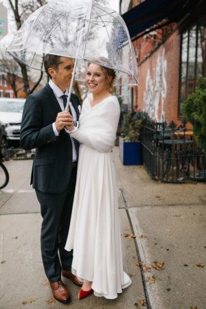 Clear Umbrella on a Rainy Wedding Day